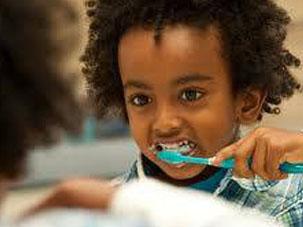 Giving children a free dental check-up. Dentist Marbella Dr Hotz.